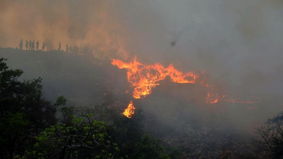 Fire engulfs Adharwadi dumping ground at Kalyan on Saturday.