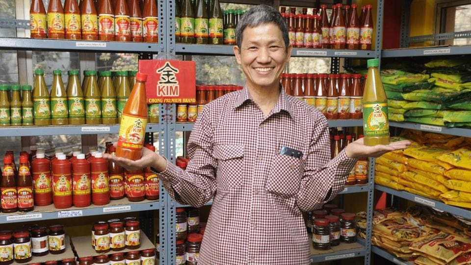 Dominic Lee, a Hakka, who owns Pou Chong, one of the most well-known brands of sauce and noodles made by the community near Tiretta Bazaar, is perceived as Mr Lee, the sauce-maker, not the Indian-Chinese sauce-maker. His professional identity, he says, has never felt eclipsed by his racial identity. (Samir Jana / HT PHOTO)