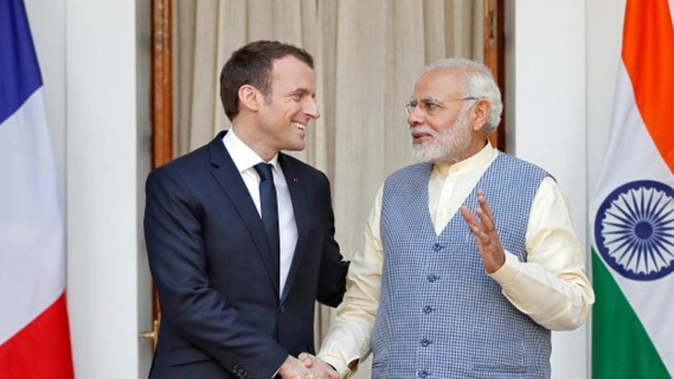 French president Emmanuel Macron shakes hands with Prime Minister Narendra Modi during a photo opportunity ahead of their meeting at Hyderabad House in New Delhi, on March 10, 2018.