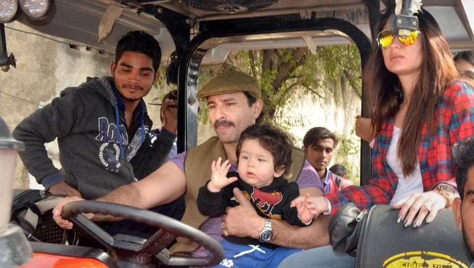 Saif Ali Khan, Kareena Kapoor Khan and their son Taimur Ali Khan ride a tractor at Pataudi Palace in Gurugram.