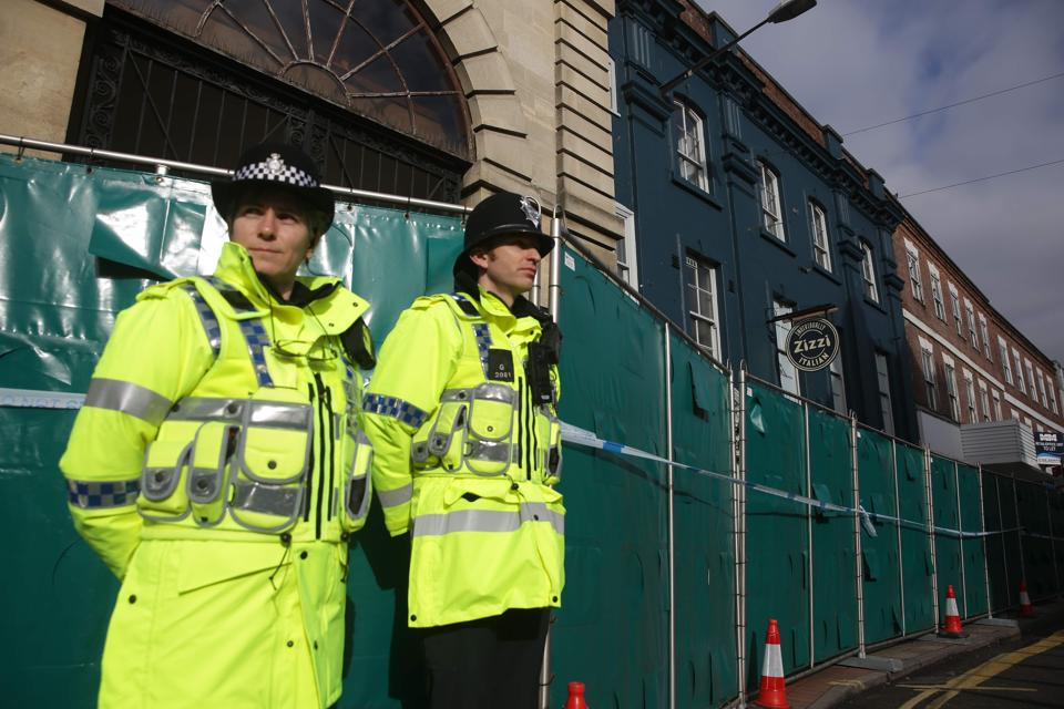 Police officers stand in front of a cordon in front the Zizzi restaurant in Salisbury on March 11, 2018.