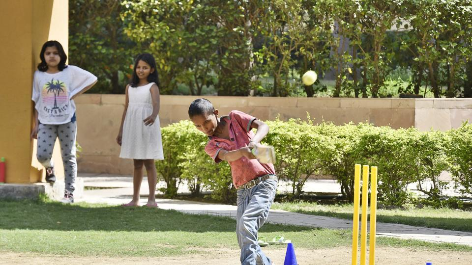 Children of residents and service staff play cricket at Fresco Apartments.