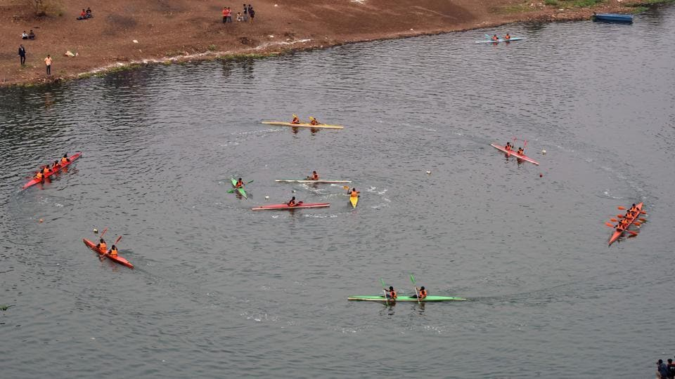 Students of COEP display Kayak Ballet during the 90th Regatta at Boat Club in Pune.  (Pratham Gokhale/HT Photo)