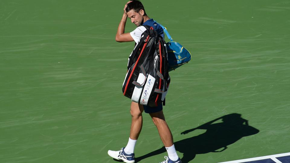 Novak Djokovic walks off the court dejected after losing against Taro Daniel in Indian Wells on Sunday.