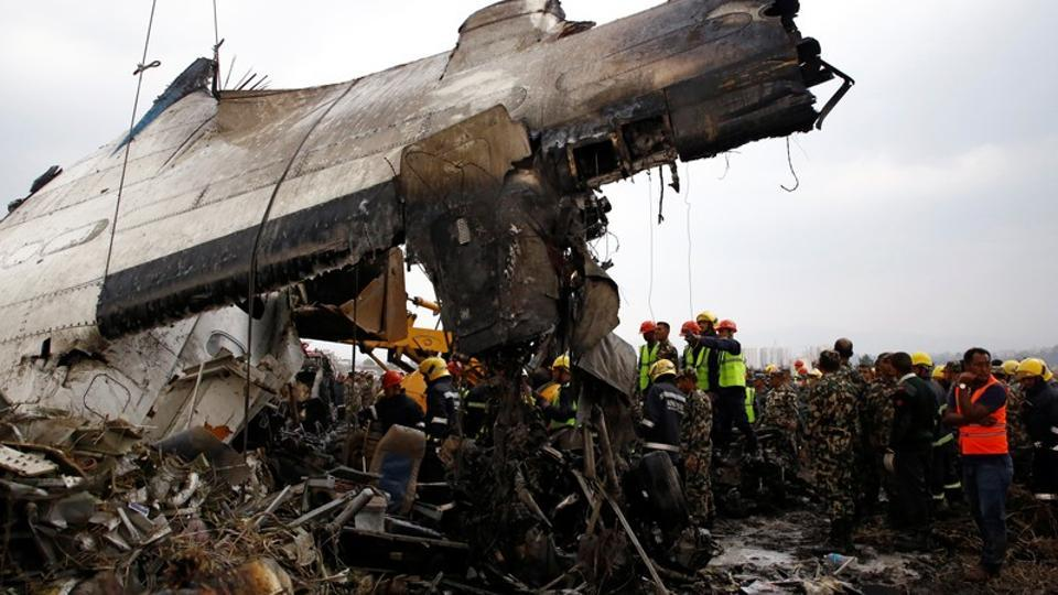 Rescue workers near the wreckage of the US-Bangla Airlines plane that crashed at the Tribhuvan International Airport in Kathmandu, Nepal March 12, 2018.