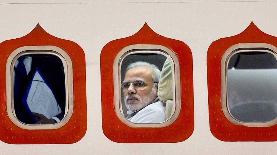 A 2014 file photo of Prime Minister Narendra Modi in his special aircraft as he arrived at the Brasilia International Airport in Brazil.