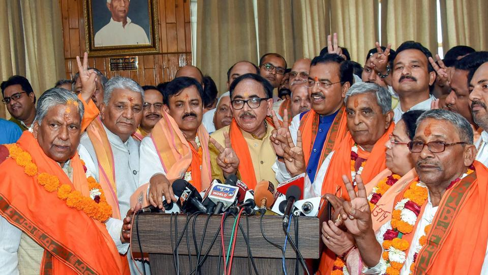BJP candidates flash a victory sign after filing their nomination papers for the Rajya Sabha election at UP Assembly in Lucknow on Monday.