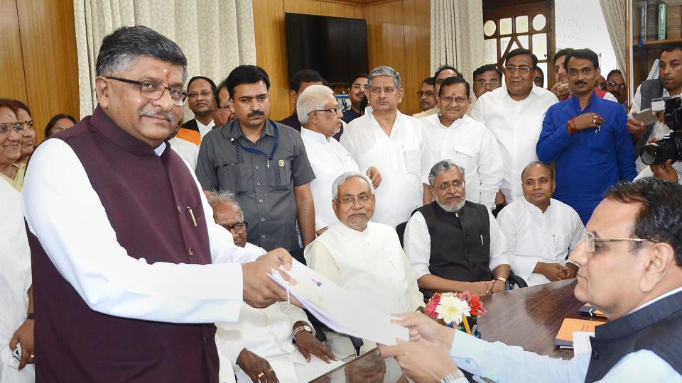 Union minister Ravi Shankar Prasad filing his nomination paper for Rajya Sabha elections in the presence of Bihar chief minister Nitish Kumar and deputy CM Sushil Kumar Modi at Bihar Assembly in Patna on Monday.