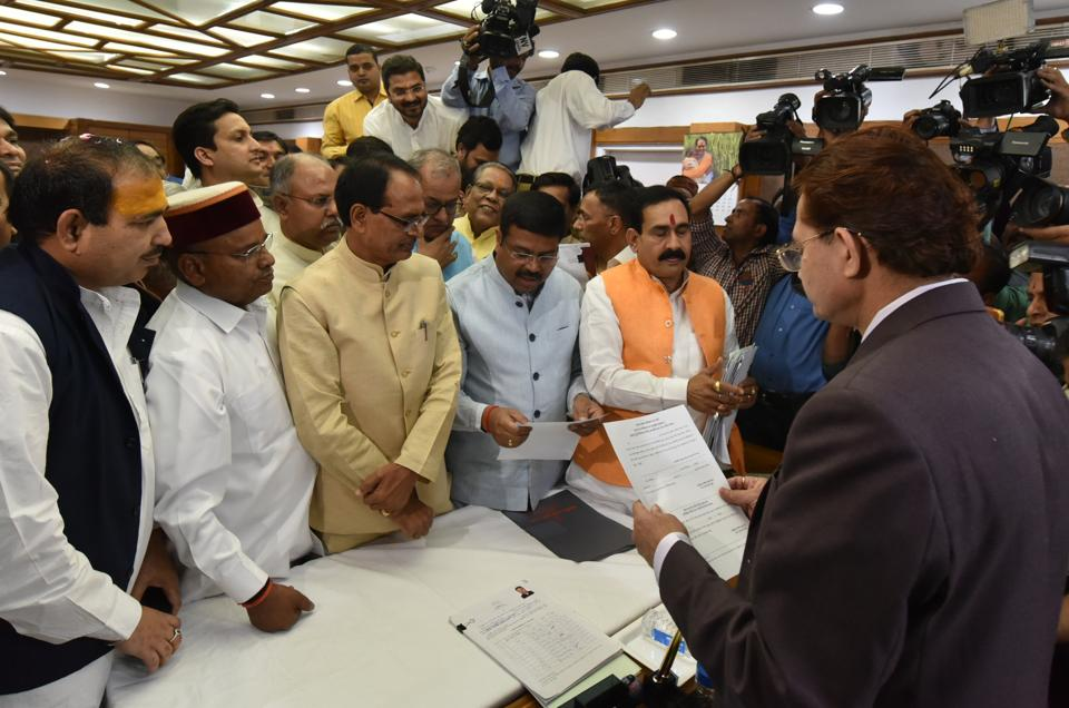 BJP candidate Dharmendra Pradhan along with other candidates Thawarchand Gehlot and Ajay Pratap Singh filing nomination papers for Rajya Sabha election in presence of chief minister Shivraj Singh Chouhan at MP state assembly premises in Bhopal on Monday (March 12, 2018). (Photo by Mujeeb Faruqui/Hindustan Times)