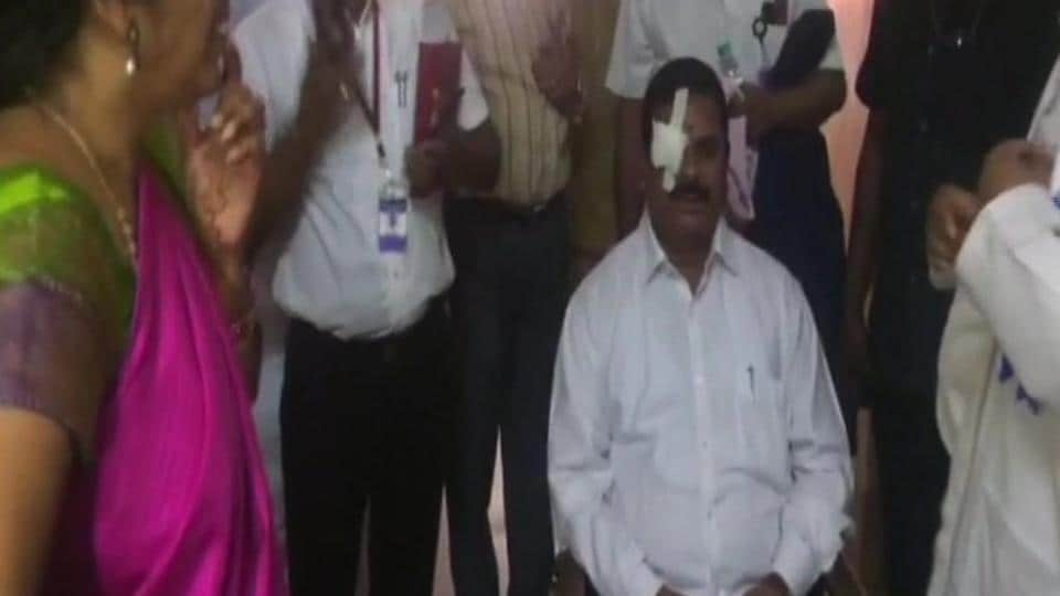 Telangana legislative council chairman K Swamy Goud suffered injuries on his right eye on Monday when a protesting Congress MLA, K V Reddy, threw a headphone at the speaker's podium during governor E S L Narasimhan's address to the joint session of the state legislature.