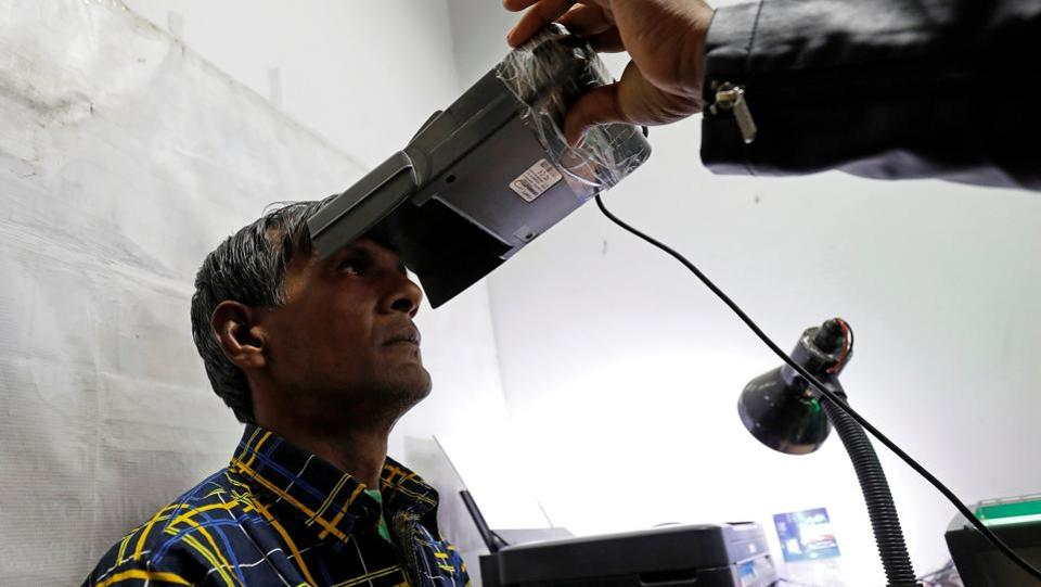 A man has his iris scanned for Aadhaar generation, at a centre in New Delhi. The Supreme Court extended on Tuesday the March 31 deadline to link Aadhaar with various services till a constitution bench hearing the matter delivers a judgment. A five-judge bench headed by Chief Justice Dipak Misra, however, said Aadhaar will continue to be mandatory for direct benefit transfers under welfare schemes. (Saumya Khandelwal / REUTERS File)