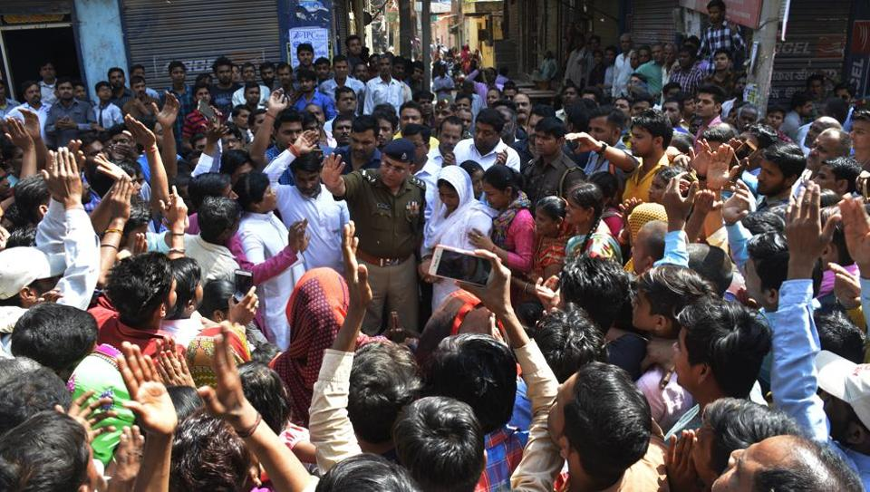 On Tuesday, after the four deaths came to light, locals staged a protest at Shankar Vihar market. The protesters criticised the local police and demanded immediate closure of shops which sell smuggled liquor.