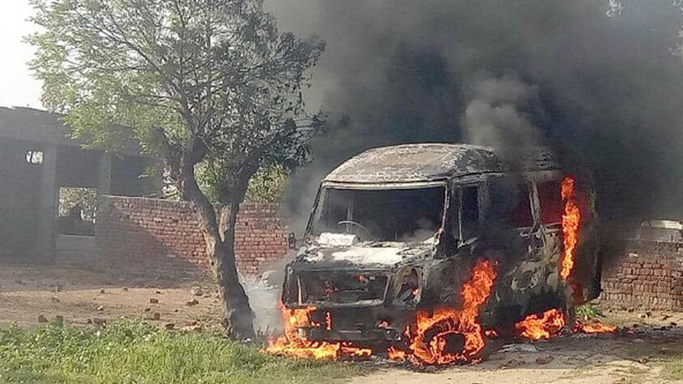 Angry villagers set a vehicle on fire at Manochahal village on Tuesday.