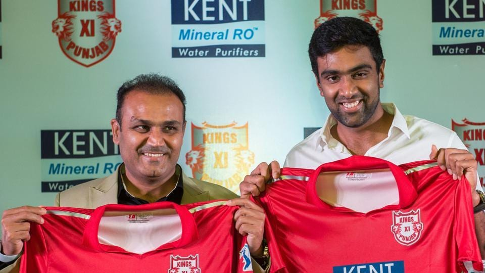 Kings XI Punjab (KXIP) mentor Virender Sehwag (L) and captain Ravichandran Ashwin unveil their team jersey for Indian Premier League (IPL) 2018 in New Delhi on Tuesday. (PTI)