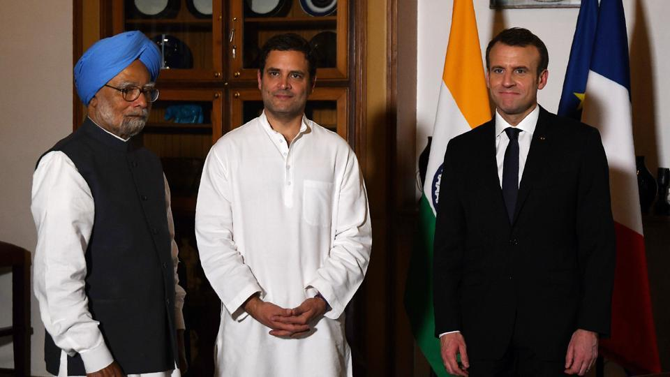 French President Emmanuel Macron, Congress president Rahul Gandhi and former prime minister Manmohan Singh pose for a photograph ahead of a meeting at the French embassy in New Delhi.