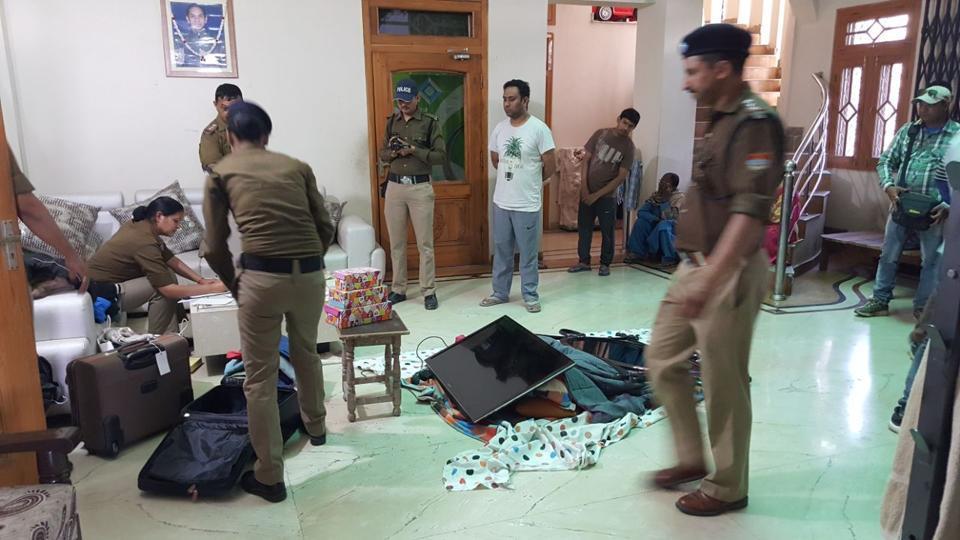 Police officials at Priya Sharma's residence.