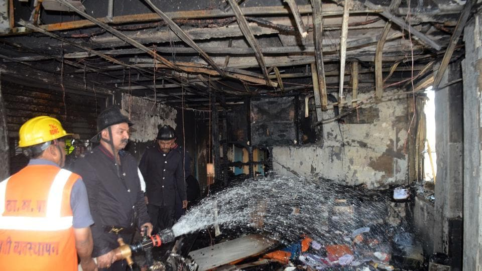 Fire fighters douse the blaze at Samarth Arcade Complex at Uthalsar in Thane.