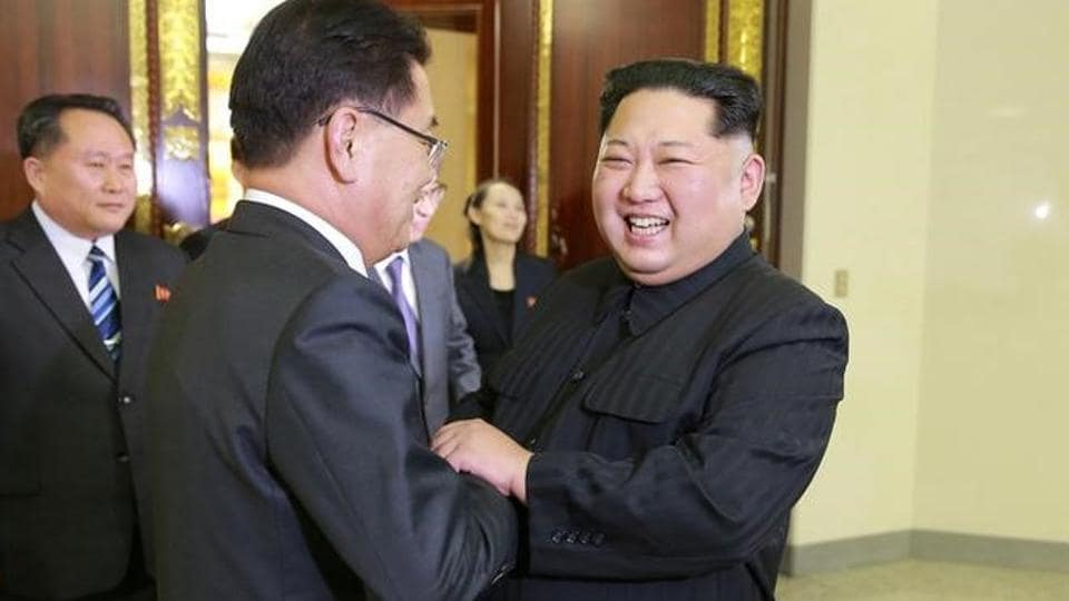 North Korean leader Kim Jong Un greets a member of the special delegation of South Korea's President at a dinner in this photo released by North Korea's Korean Central News Agency on March 6.