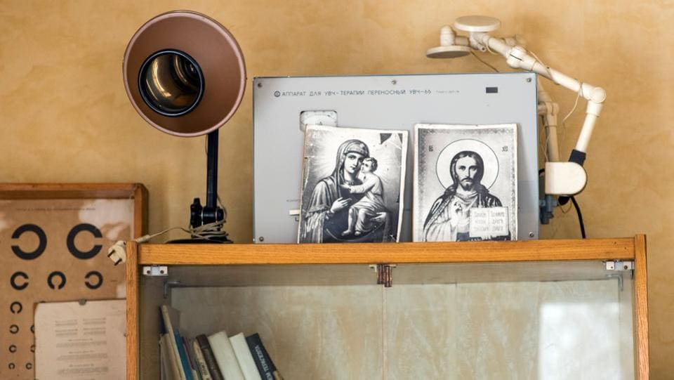 Images of religious icons are displayed alongside old equipment in a clinic in the village of Gvozdyv. His practice, 35 kilometres outside Kiev, is still stuck with Soviet-era medical equipment and lacks basic supplies. Life expectancy in Ukraine is on average five years shorter than the European average, according to the World Health Organization. (Gleb Garanich / REUTERS)