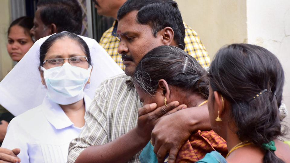 Relatives of the trekkers injured in Korangani reserve forest fire wail outside the Theni Government Medical College hospital, in Theni on Monday.