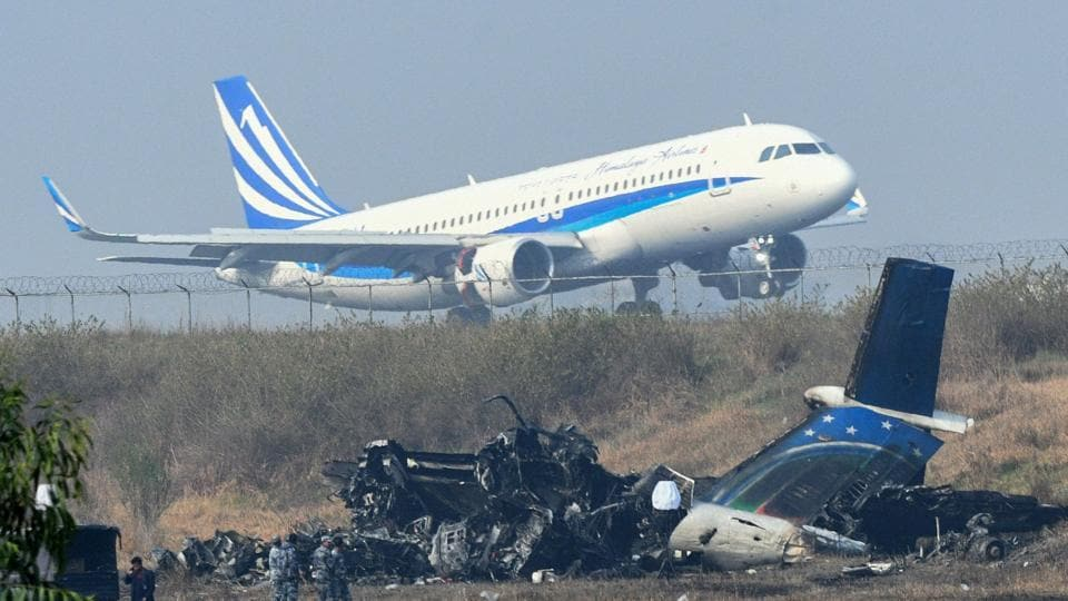 An Airplane Takes Off At The International Airport In Kathmandu On Tuesday Near The Wreckage Of