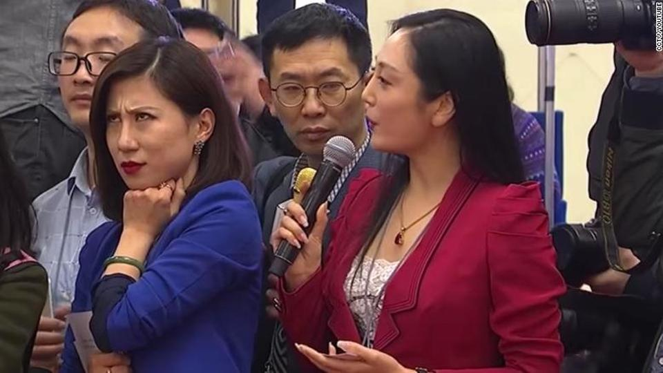 Yicai financial news service reporter Liang Xiangyi sighed and raised a sceptical eyebrow at another journalist's query to a delegate at a National People's Congress press event Tuesday.