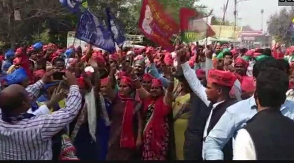 Samajwadi Party and Bahujan Samaj Party workers celebrate in Gorakhpur as their party candidate leads in UP bypolls onWednesday.