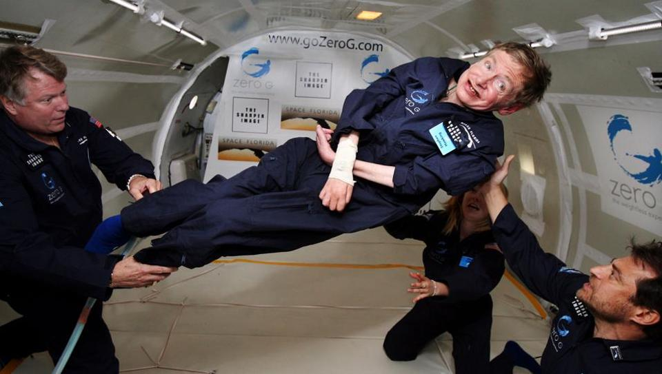 British cosmologist Stephen Hawking experiences zero gravity during a flight over the Atlantic Ocean.