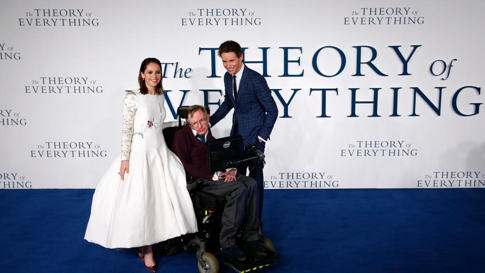 Scientist Stephen Hawking with British actors Felicity Jones (L) and Eddie Redmayne (R) at the UK premiere of the film 'The Theory of Everything' in London in 2014. The film was based on the memoir Travelling to Infinity: My Life with Stephen, by Jane Hawking, the scientist's first wife.