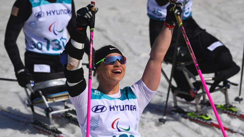 Oksana Masters of the US celebrates her victory after crossing the finish line in the women's 1.1km sprint sitting cross-country skiing final event of the Pyeongchang Winter Paralympics at the Alpensia Biathlon Centre.