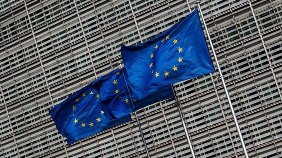 European Union flags flutter outside the EU Commission headquarters in Brussels, Belgium, March 12, 2018.