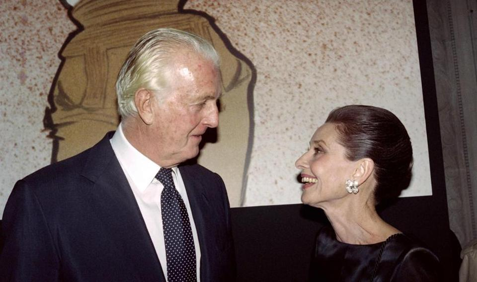 In this file photo taken on October 21, 1991 Hubert de Givenchy (L) is seen with actor Audrey Hepburn — the designer's muse for almost four decades.