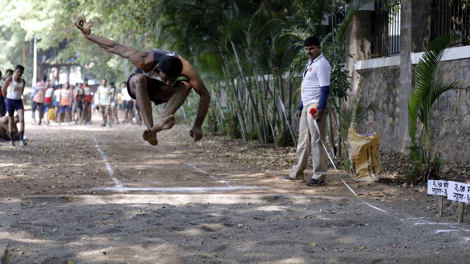 A police aspirant performs long jump at the police recruitment drive at Shivajinagar Police Headquaters in Pune.  (rahul raut/ht photo )