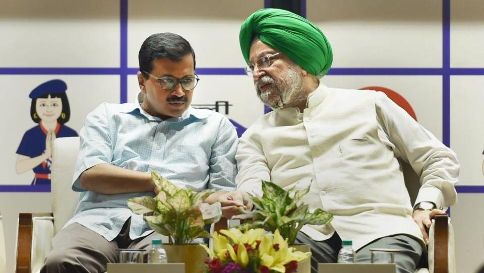 Union minister for urban development Hardeep Singh Puri and Delhi CM Arvind Kejriwal during the inauguration of Delhi Metro Pink Line at DMRC Bhawan, in New Delhi on Wednesday.