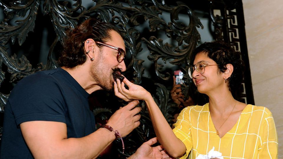 Kiran Rao Khan  feeds birthday cake to her husband Aamir Khan during his 53th birthday celebration in Mumbai on March 14, 2018.