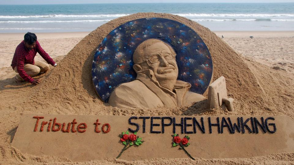 "Sand artist Sudarsan Patnaik gives final touches to a sculpture in honour of British physicist and award-winning author Stephen Hawking at Puri beach on Wednesday. Hawking passed away today, aged 76. Propelled to superstardom by his 1988 book ""A Brief History of Time"", Hawking dedicated his life to unlocking the secrets of the Universe. (Asit Kumar / AFP)"