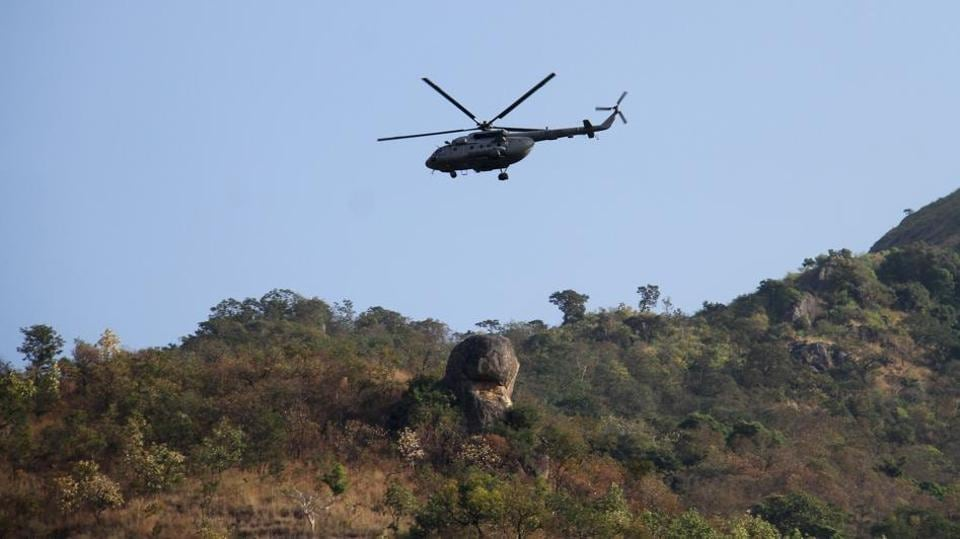An air force helicopter patrols during a rescue mission at Kurangani Hill in the district of Theni on March 12, 2018.