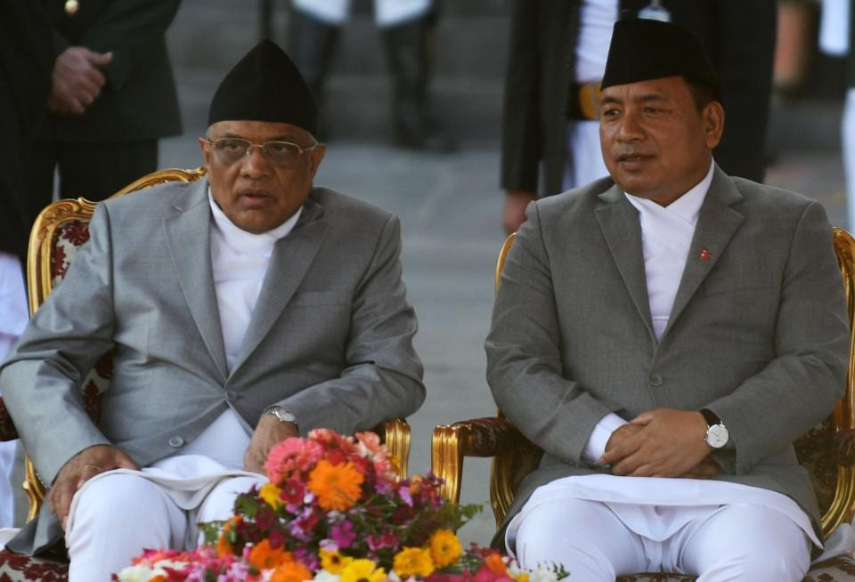 Nepal's Chief Justice Gopal Prasad Parajuli (left) with vice president Nanda Kishor Pur (right) in Kathmandu on March 14, 2018.