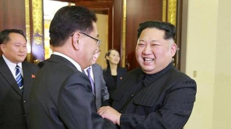 North Korean leader Kim Jong Un greets a member of the special delegation of South Korea's President at a dinner in this photo released by North Korea's Korean Central News Agency (KCNA).