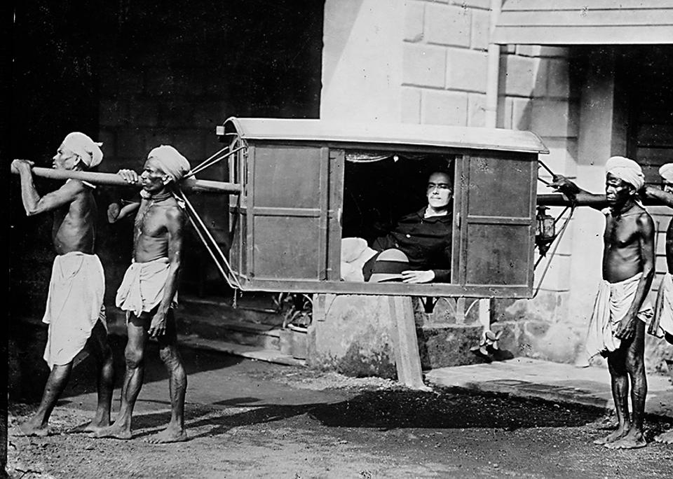 Plain tales from the Raj: An English merchant in a palanquin, 1922.