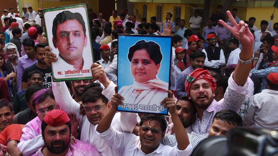Samajwadi Party workers celebrate their party's victory in Gorakhpur and Phulpur Lok Sabha by-poll elections in Lucknow on Wednesday. Candidates of the Samajwadi Party consolidated leads over nearest BJP rivals in Gorakhpur and Phulpur Lok Sabha seats in Uttar Pradesh, latest trends showed. In Bihar, the RJD won in Jehanabad, while the BJP won Bhabua. In the third seat, Araria, Lalu Prasad's RJD is leading by 86,000 votes. (Subhankar Chakraborty / HT Photo)