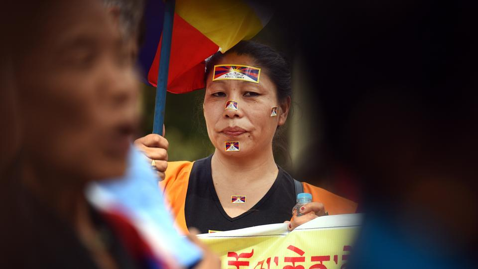 Tibetan people hold placards and flags during a peaceful protest against the Chinese government during commemorations of the 10th anniversary of the Tibetan Uprising, at Parliament Street near Jantar Mantar on Wednesday. (Raj K Raj / HT Photo)