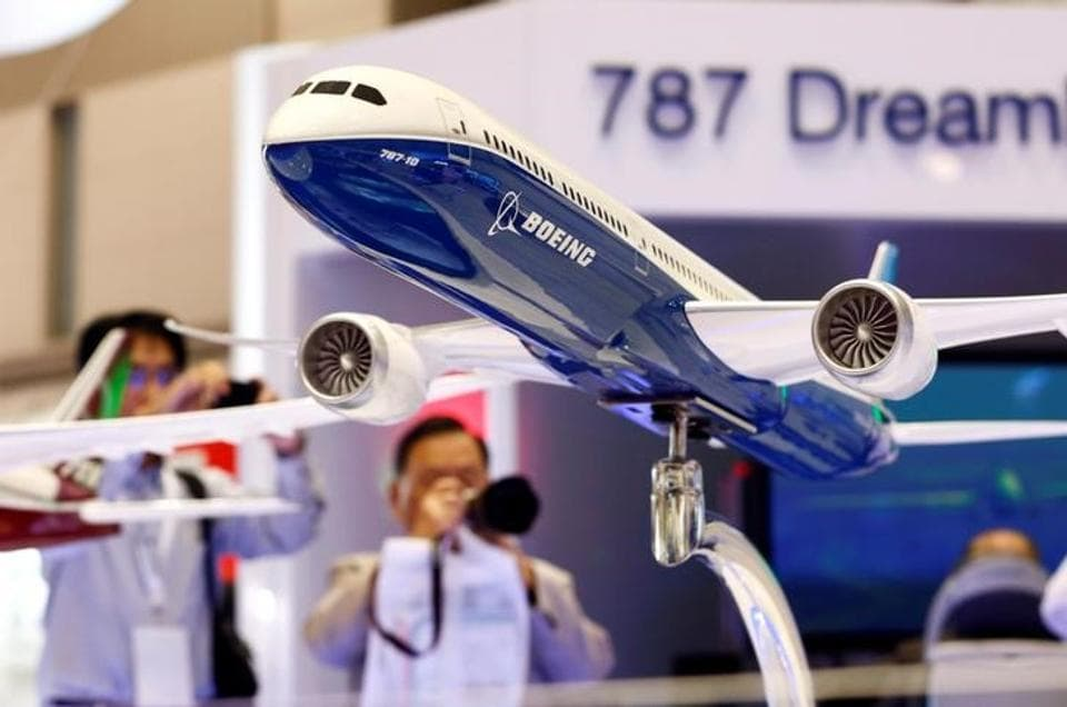 Visitors take pictures of a model of Boeing's 787 Dreamliner during Japan Aerospace 2016 air show in Tokyo October 12, 2016.