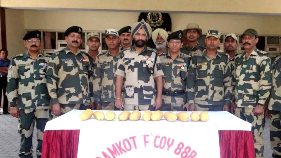 BSF officials with the recovered contraband in Amritsar on Thursday.