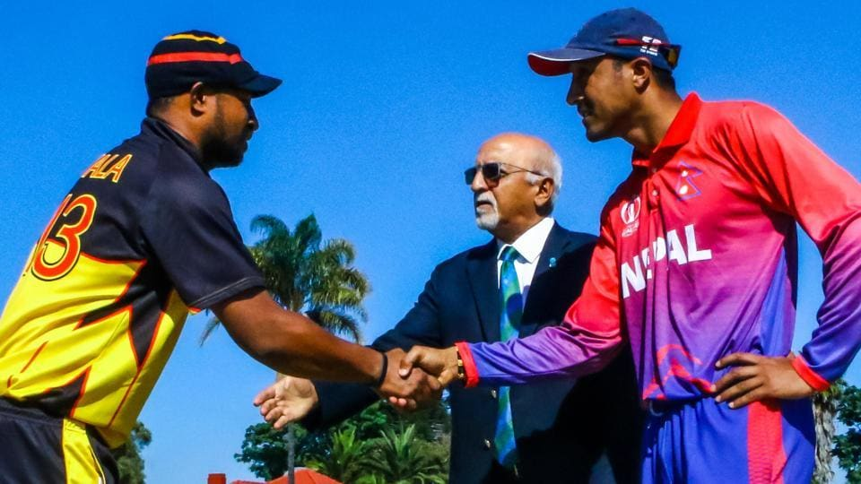 PNG captain Assadollah Vala (L) shakes hands with Nepal captain Paras Khadka (R).  (ICC)