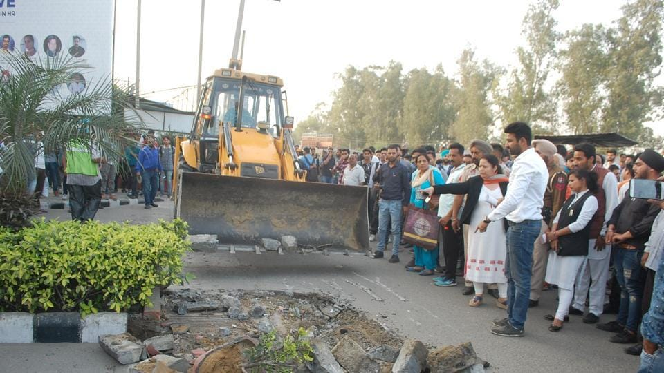 Police official during the anti-encroachment drive at Lovely Professional University in Phagwara on Wednesday.