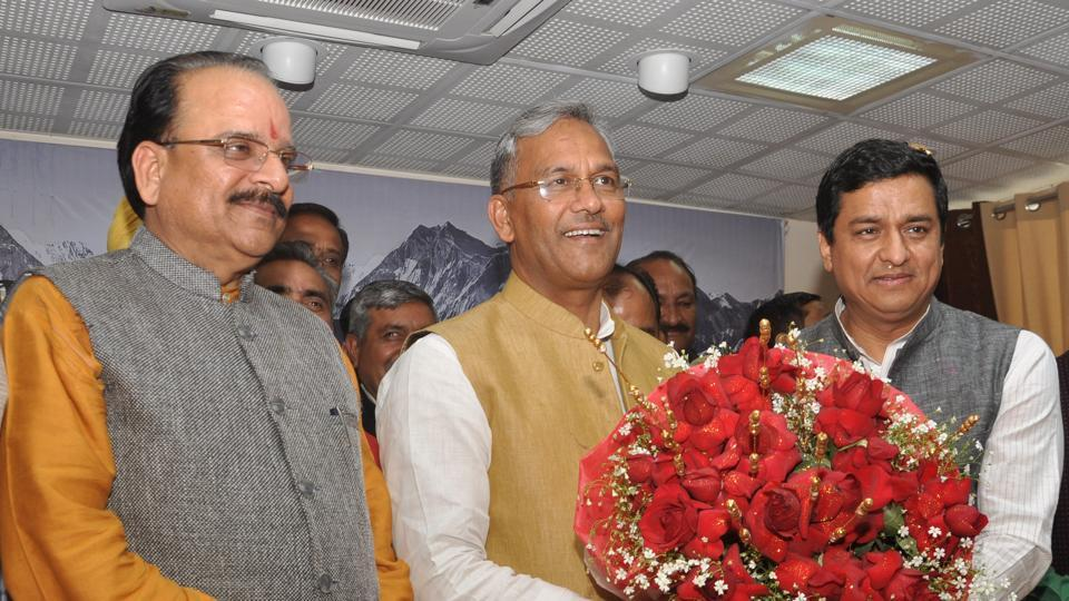 Chief Minister TS Rawat (C) welcomes Anil Baluni after he was elected to the Rajya Sabha.