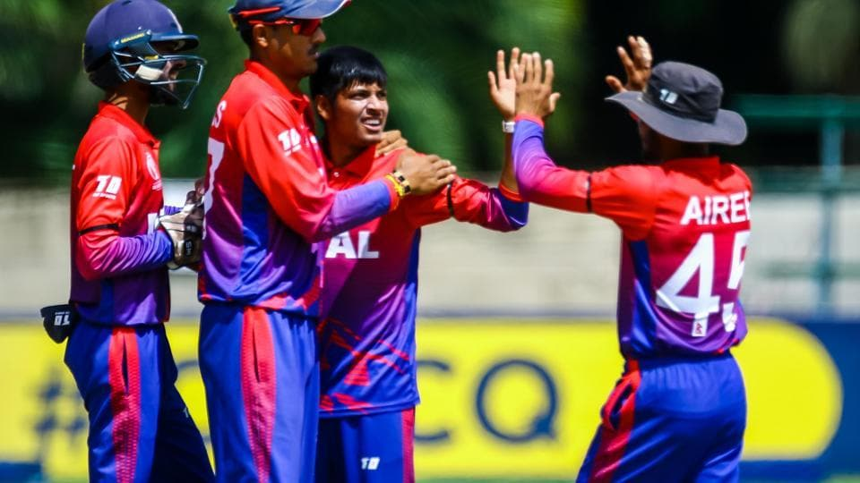 Sandeep Lamichhane celebrates after taking a wicket against Papua New Guinea. (ICC)
