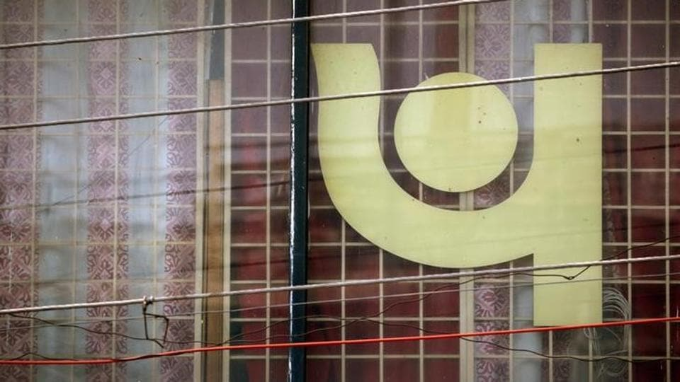 The logo of Punjab National Bank (PNB) is seen on a branch office window in New Delhi.