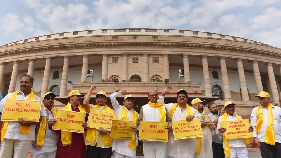 TDP leaders hold placards and shout slogans demanding special status for Andhra Pradesh, during the ongoing budget session at Parliament House in New Delhi.